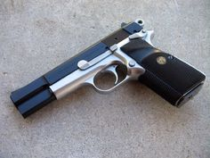 Browning Hi Power Practical 9mm was the best looking handgun but was tempermental in what you fed it. Felt great in my hand. Fit well.