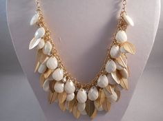 3 Row bib Necklace with Gold Tone Leeves and White bead dangles by maryannsway on etsy