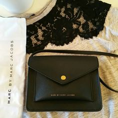 """BOGO 50% Marc Jacobs • Black Mini Crossbody Bag Authentic Marc Jacobs Cute everyday go to black mini crossbody. In pristine condition. Has a slide in front & back pocket. Inside, one full compartment that can fit a Galaxy Note 4, credit cards, & lipsticks.  Adjustable strap. Comes with dustbag and tags.  Used a handful of times.  Very functional bag.  No scuffs, scratches, or odor.  Comes from a smoke and pet free home. Length: 6 3/4"""" // Width"""" 3"""" // Height: 5.5"""" Marc by Marc Jacobs Bags…"""