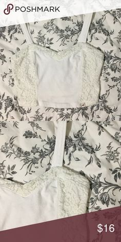 4e8dc1b6d9ae6f White hollister crop top White tank crop top with white lacy detailing on  the sides