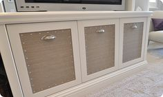 Grasscloth wallpaper on the doors attached with nailhead trim. Nail heads can go anywhere...I love it!