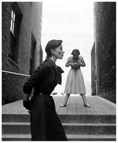 Bettina Graziani ('Bettina') models fall college clothes for Vogue photographer Frances McLaughlin-Gill across from New York's Hunter College, photographed by Gordon Parks, 1950.