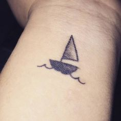 "Sailboat tattoo on wrist ""I am not afraid of storms, for I am learning how to sail my ship"" - louisa may alcott"