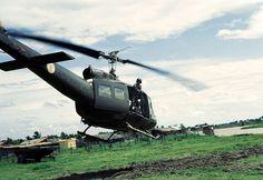 Vietnam War 1967 - A door gunner surveys the area in the Mekong Delta