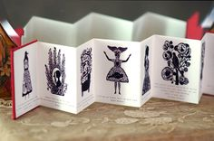 Incredibly intricate Miniature Artist Books by Elsa Mora, aka Elsita. Each pint-sized volume is unique, and comes elegantly presented with a tiny and beautiful sleeve, box, or bow.
