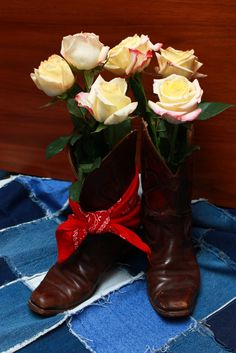 """Great way to use old cowboy/girl boots: take flower vases (we actually used tall glass jars that green olives come in) and put the vases inside the boots for a """"western""""/""""country"""" table decoration. Country Table Decorations, Western Decorations, Tea Party Table, Party Tables, Old Boots, Cowboy Girl, Candy Buffet, Flower Vases, Glass Jars"""