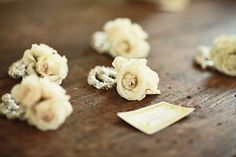 The house party members will have ivory spray rose wrist corsages in ivory pearl bracelets.  The mothers will have similar corsages with lavender spray roses.