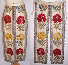 Czech folk costume silk embroidered apron skirt panel dates from the late 19th century. It is hand stitched, made of an off white silk fabric, with colorful silk raised padded satin stitch hand embroidery work, silver and silver metallic thread outlines the floral pattern design.