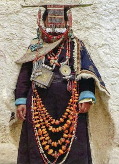 kind of Tibetan regional costume with lots of traditional jewelry and ornaments