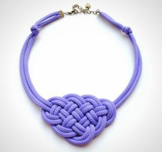 Add a pop of color to any outfit with this knotted necklace.