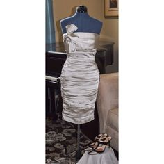Calvin Klein Champagne Dress Calvin Klein strapless silk dress. Ruched bottom topped with a sophisticated side now. Falls right around the knee area. Calvin Klein Dresses