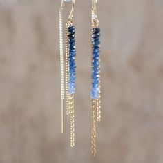Dazzling natural sapphire gems have been carefully hand-picked and strung to create this beautiful ombre effect. They have been hand crafted into this elegant U-threader earrings.  Elegant, sexy, modern! Great gift for a September girl!  •Natural, hand-cut Blue Sapphire gems are 2.75-3mm approx •14K Gold Fill findings •Total length of the earrings are 57mm/2.2 inches from the top of the U wire to the end of the chain. •Sapphire part measures 26mm/just over an inch in total.   More S...