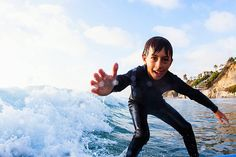 Young boy surfing, Encinitas, California, USA