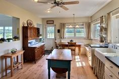 Farmhouse style rooms from all around the house. Love how this one has a giant unpainted Hoosier cabinet / cupboard instead of all built-in kitchen cabinets.