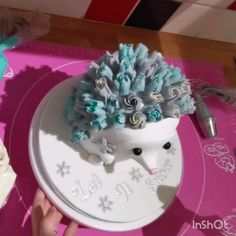 a video showing me decorate an original buttercream flower hedgehog cake. piping using russian nozzles. written tutorial on Little Peach Cakery website link