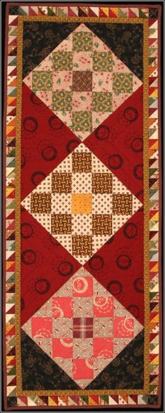 Checkerboard table runner -interesting. While am not a fan of all the colors used, I do love the tiny triangle border.
