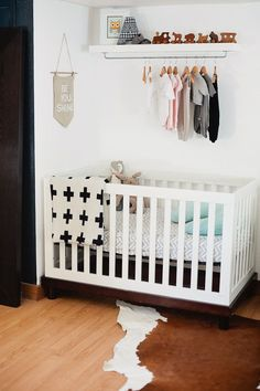 DIY Nursery Wardrobe Shelf in a sweet and simple gender neutral nursery.   A Redesigned Master Bedroom and Nursery Suite in Navy (Chimney Smoke from Valspar) Blue and White with Fresh Mommy Blog and Valspar Paint Zero VOC