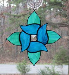 Stained Glass Suncatcher, Swirl Flower in Aqua Blue & Teal Wispy. $19.00, via Etsy.