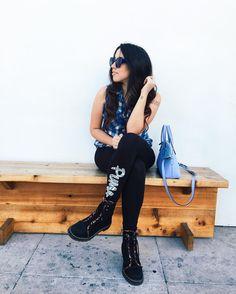 Bruna Vieira com legging e bota de cano baixo.