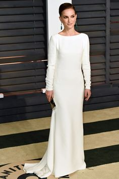 Natalie Portman wore a white gown and carried an Eddie Borgo clutch.
