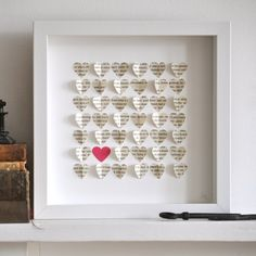 wall Art!  Little printed hearts mounted on a white background. The hearts are created from a recycled antique book.