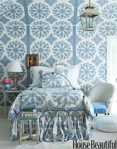 """Designer Windsor Smith decorated a Los Angeles family home in a glamorous, feminine style. The 10-year-old daughter's bedroom is """"young Indian princess meets modern preteen."""" Walls are covered in Peter Dunham's Samarkand. With the vintage iron bed's duvet and bedskirt in the same paisley print, the effect is lavishly girly."""
