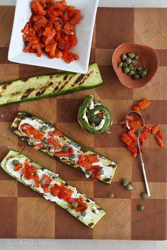 grilled zucchini rolls with goat cheese, roasted peppers & capers