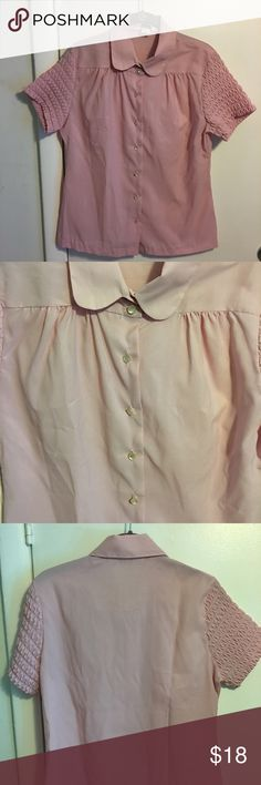 "CLEARANCE!!! 2 for $15 1970's pink vintage blouse from Montgomery Ward. Cute ruching on the sleeves. Fabric is polyester. Measurements: armpit to armpit 19"", length 25"". Great vintage condition. However the buttons could use some tightening but they are all attached and accounted for. No size tag but it fits me and I usually wear a medium. Vintage Tops Blouses"