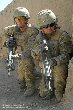 Royal Marines from 40 Commando on patrol in the Sangin area of Afghanistan are pictured (left) with a General Purpose Machine Gun or GPMG and (right) the newly introduced L129A1 or Sharpshooter 7.62mm rifle.