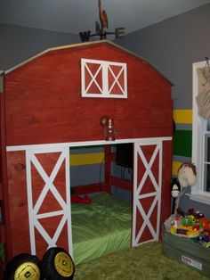 See the tractor wheel pillows? wouldn't every little farm boy LOVE a room like this? I am going to see if I can't make this a little play barn for Carson and his toys! how cute:)