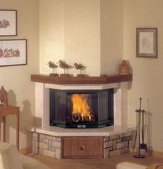 Traditional Corner Fireplace Ideas to Charm. Let not an awkward corner make you be devoid of amazing ideas for your fireplace Corner Fireplace Tv Stand, Corner Fireplace Mantels, Electric Fireplace Tv Stand, Fireplace Inserts, Fireplace Ideas, Fireplace Design, Fake Fire, Fireplace Remodel, Wood Burner