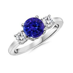 Proportions of Tanzanite with diamonds either side except in rub-over / bezel setting.