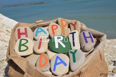 Happy Birthday composition of stone letters in a bag