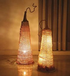 These lights are the Luminous Pods; the crochet pattern can be found in Unexpected Crochet for the Home. They are made with a combination of cotton yarn and hemp yarn.