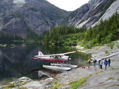 Alaska float plane ride with mountain lake landing.