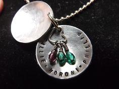 $29.50 Inside of a hand stamped locket with birthstones.  www.fb.com/inspiredcreationsbyheidi