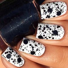 Black and White Splattered Nail Design