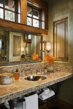 Love the windows, mosaic tile counter top and natural color scheme,