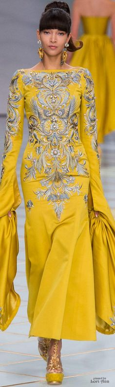 little unpractical sleeves get caught in all manner of things including dinner, but I love this one, trim down the sleeves   2  .. otherwise 3 ....Guo Pei Couture Spring 2016