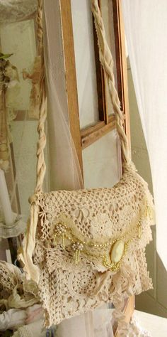 One of a kind boho bag created with beads, old textiles and lace.