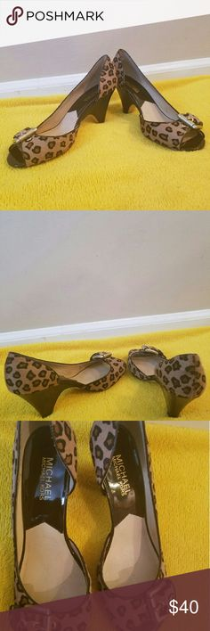 Micheal Kors animal print kitten heel Size 8. Gently used. Slight signs of wear as shown in photos. Still a lot of life left in these shoes MICHAEL Michael Kors Shoes Heels