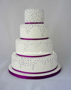 Purple, silver and white pearls 4 tier dainty wedding cake