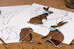 stained glass rabbits in the making by Jenny Newall