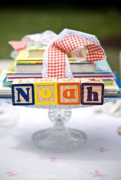 Our center piece on each table was a cake stand with a stack of classic children's books collected from the thrift store that Genna got to keep to help start Noah's collection and of course it was tied beautifully with ribbon.