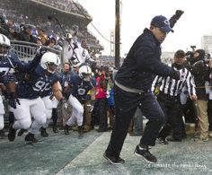 PENN STATE – FOOTBALL 2013 – Penn State head coach Bill O'Brien leads the team onto the field at Beaver Stadium. Penn State fell to Nebraska, 23-20 in overtime. Joe Hermitt, PennLive.com