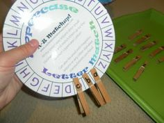 matching lower case letter clothespins to the upper case letter wheel