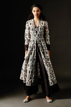 <p>Featuring a grand, full-length monochrome kurta in net brocade…