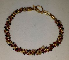 Hey, I found this really awesome Etsy listing at https://www.etsy.com/listing/182328738/kumihimo-beaded-bracelet