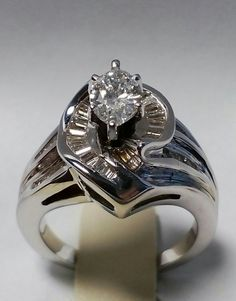 T&Co 05228346  Total Diamond 2.12ct MARQUISE 0.90ct F/VS  BAGUETTE 1.12ct G/VS  Price: $24 000
