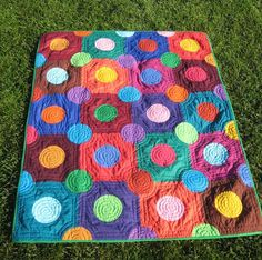 Solid colored dots on squares quilt